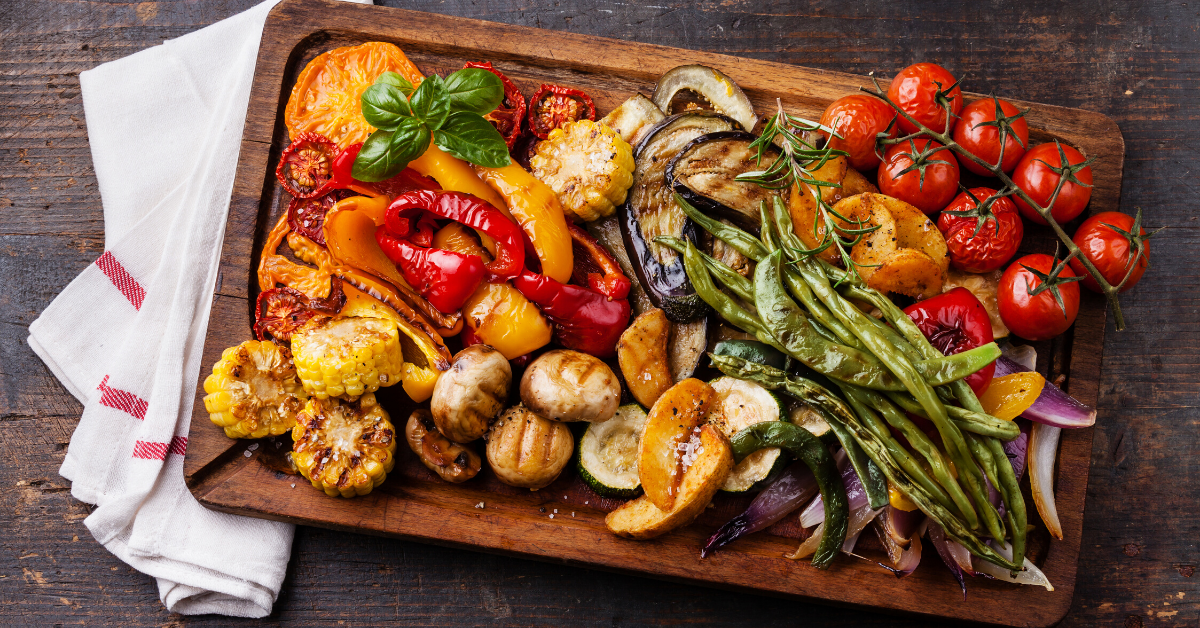 Roasted vegetables in a cutting board - Plan healthy family meals in 5 steps - Whole Family Living