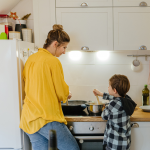 Mom and child planning a healthy family meal in the kitchen.