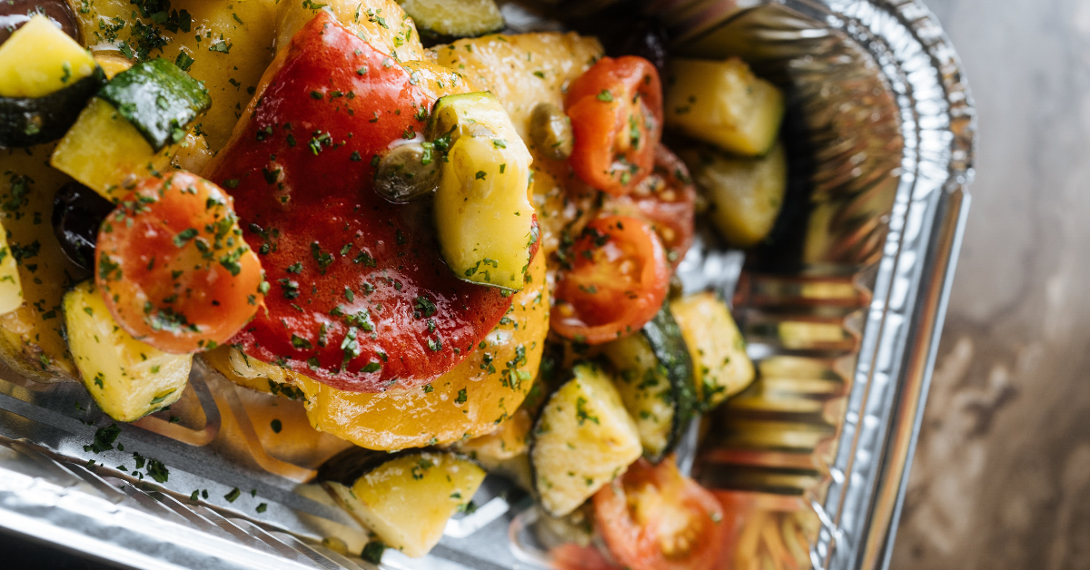 Roasted vegetables in an aluminum pan - Plan healthy family meals in 5 steps - Whole Family Living