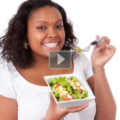 12 Ways to Make Healthy Eating a Habit That Sticks - Whole Family Living. Attractive young woman eating a healthy salad.