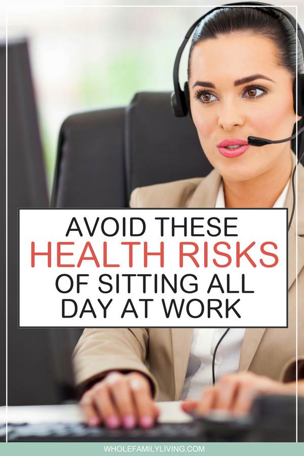 Sitting All Day at Work May be Ruining Your Health. Woman at work sitting at computer desk wearing a telephone headset.