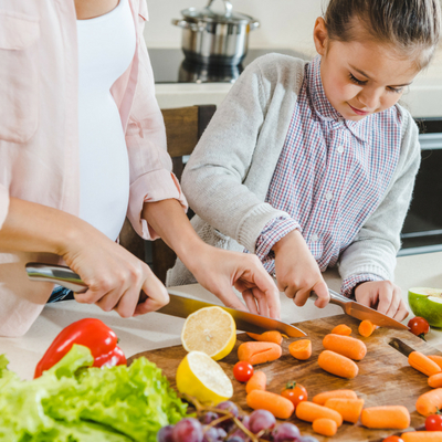 Are Meal Kit Delivery Services Right for Your Family - Whole Family Living. Mother and Daughter cutting vegetables in the kitchen.
