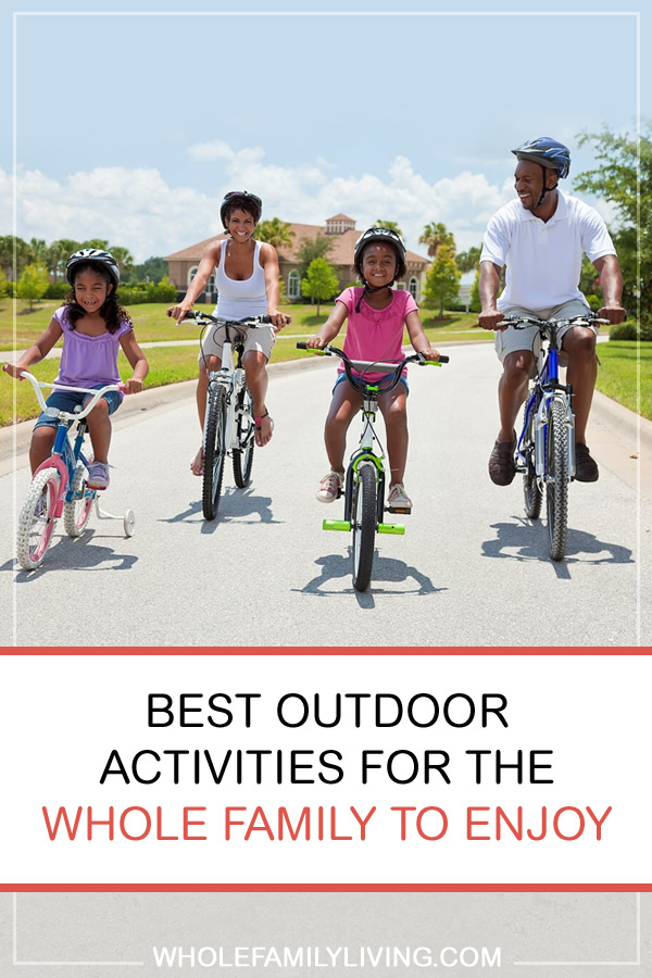 Best Outdoor Activities for the Whole Family. Family of four riding bicycles outside while wearing safety helmets.