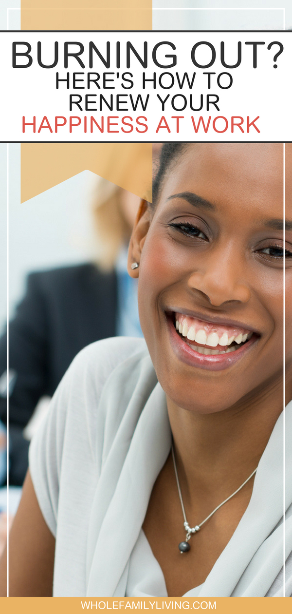 Burning Out? Here's How to Renew Your Happiness at Work. Woman smiling during business meeting.