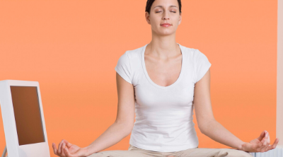 Woman doing yoga on her desk at work. How to Manage Stress at Work - Whole Family Living