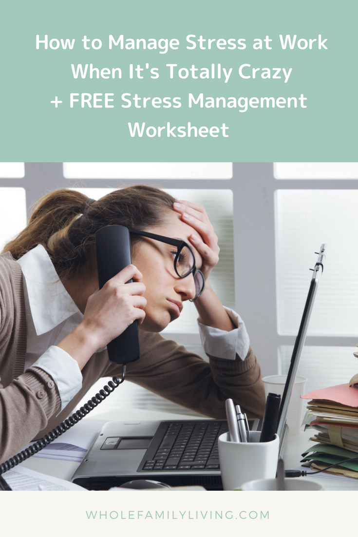 How to Manage Stress at Work - Female employee talking on the phone with piles of paperwork on her desk.