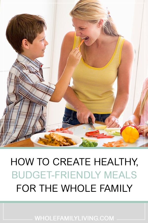 Creating Healthy, Budget-friendly Meals for the Whole Family. Mom and two kids in kitchen chopping veggies and preparing a healthy meal.