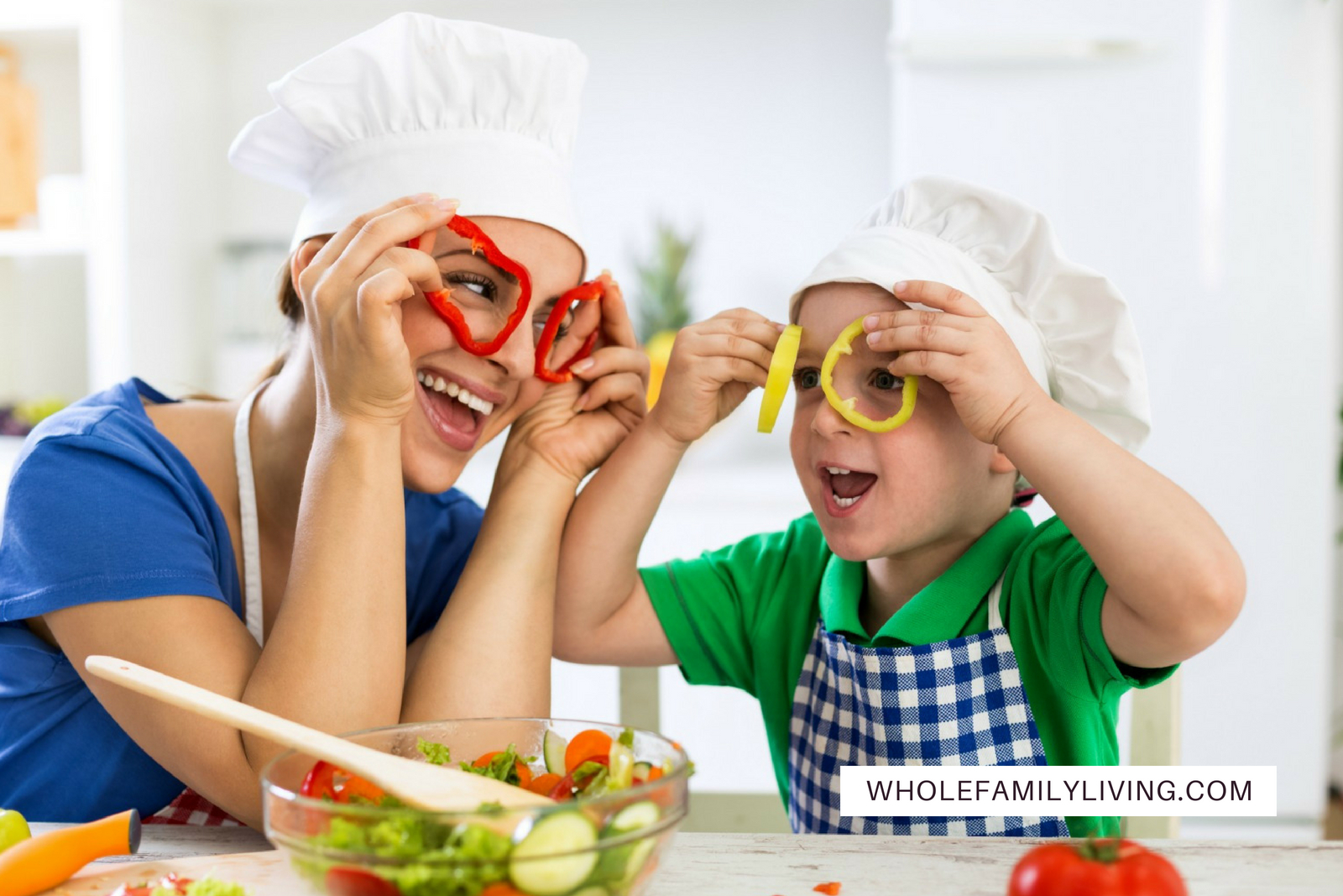 My Plate: Healthy Eating for Busy Families Made Easy. Mother and son having fun cutting up veggies in the kitchen.