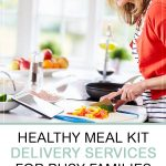 Healthy Meal Kit Delivery Services for Busy Families. Mom following recipe and preparing a family meal.