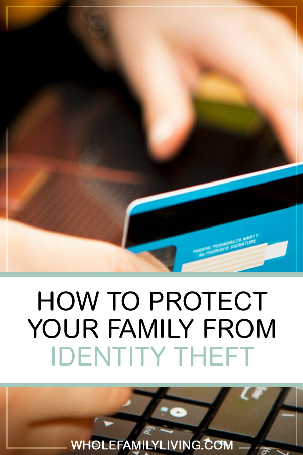 How to Protect Your Family From Identity Theft. Person holding a credit card in hand to pay for an online purchase.