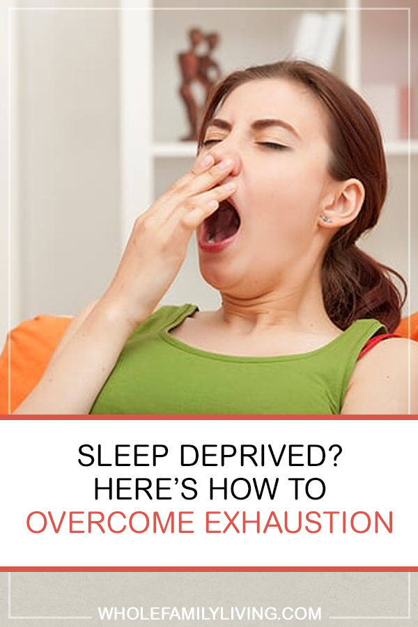 Overcome Exhaustion: Tips for Better Sleep. Tired woman sitting on the couch yawning.