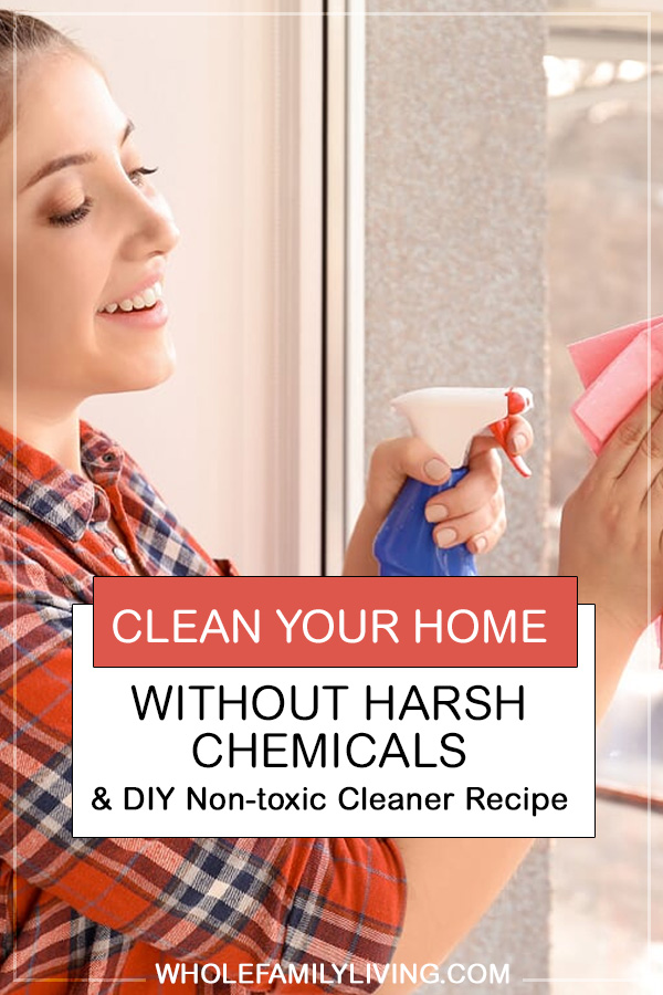 Spring Clean Your Home Without Harsh Chemicals. Woman using natural DIY cleaners to clean glass door.