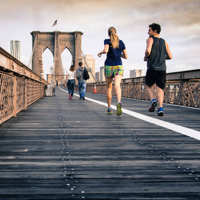 8 Healthy Habits to Start Your Day Off Right - man and woman jogging over a bridge