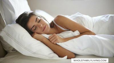Benefits of Getting Adequate Sleep to Maintain Good Health - Whole Family Living. Woman sleeping in bed.