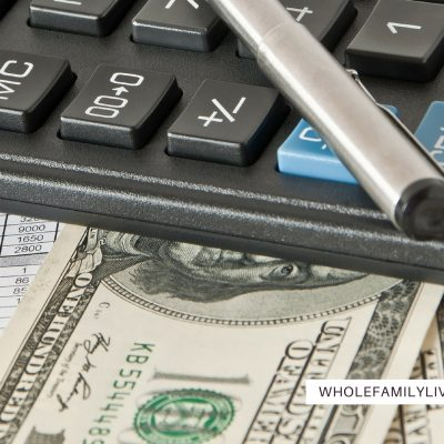 Keys to Creating an Effective Family Budget - Whole Family Living. Calculator, spreadsheet, pen, and money on a desk.