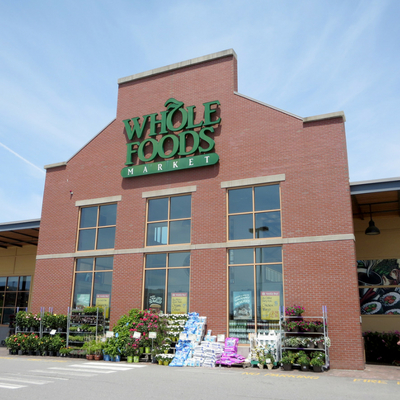 Smart and Easy Ways to Save at Whole Foods Market - Whole Family Living. Exterior of a Whole Foods Market grocery store.