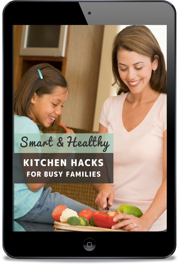 Smart and Healthy Kitchen Hacks for Busy Families - Whole Family Living. Cover image of a healthy eating guide, with mother and daughter prepping vegetables in the kitchen.
