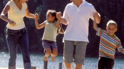 Family walking on a pier. Setting Healthy Family Goals - Whole Family Living