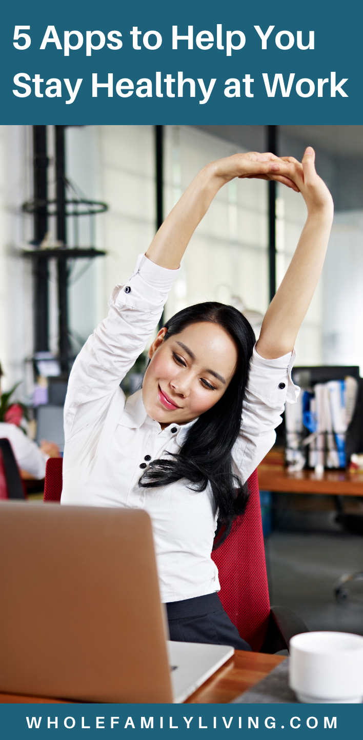 Woman taking a stretch break at work. Apps to Help You Stay Healthy at Work - Whole Family Living