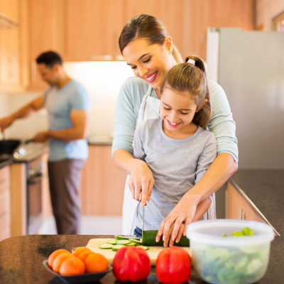 Family preparing a healthy meal. How to Get Your Family Excited About Mealtime - Whole Family Living