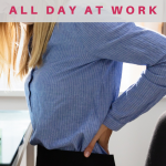 Woman having back pain sitting at work desk. Health Risks of Sitting All Day at Work - Whole Family Living