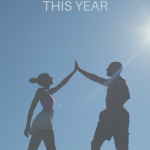 Man and woman on a summit giving each other a high five. 7 Steps to Conquer Your Goals This Year (Without Resolutions) - Whole Family Living
