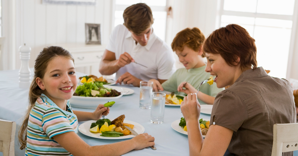 Family having dinner together. 17 Examples of Family Goals to Work on This Year - Whole Family Living
