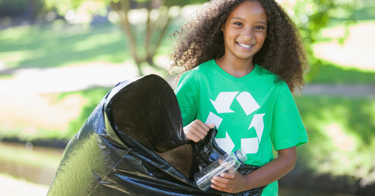 Young girl doing community service work cleaning up trash. 17 Examples of Family Goals to Work on This Year - Whole Family Living