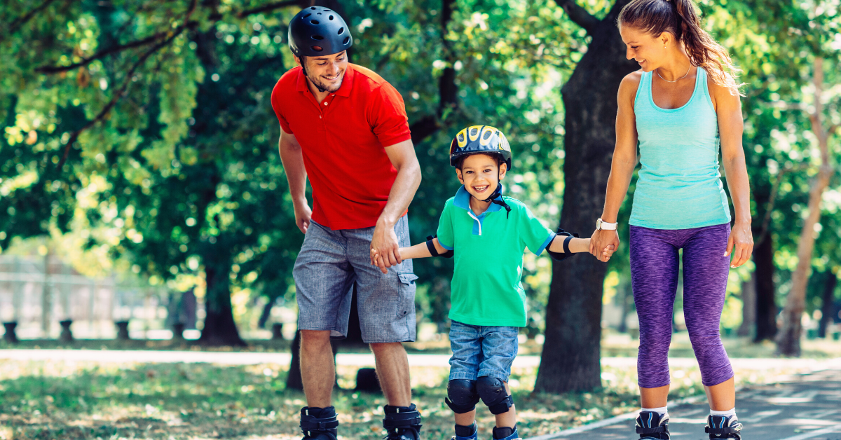 Family at the park rollerskating. 17 Examples of Family Goals to Work on This Year - Whole Family Living