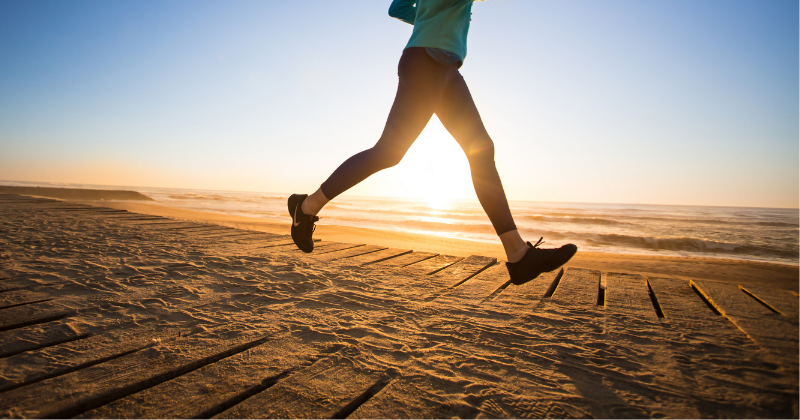Woman running for exercise at sunrise. Wellness Challenges to Improve Your Health - Whole Family Living