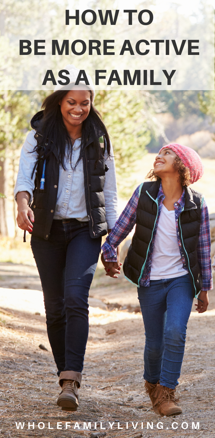 Family of mother and daughter being active, walking outdoors. Family fitness