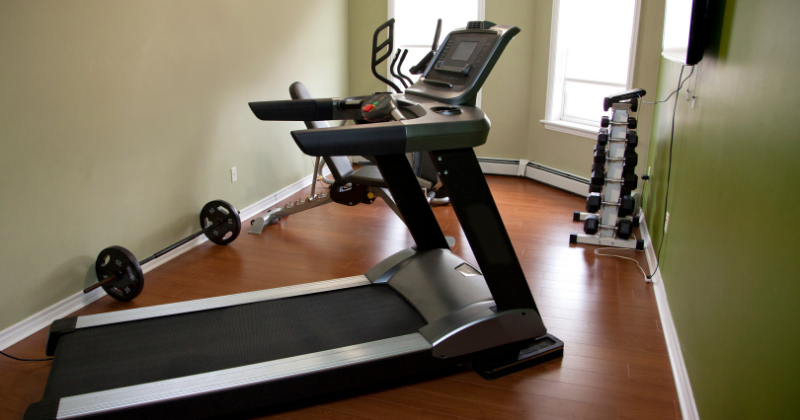 Home gym with treadmill and weights. Affordable Home Gym Equipment - Whole Family Living