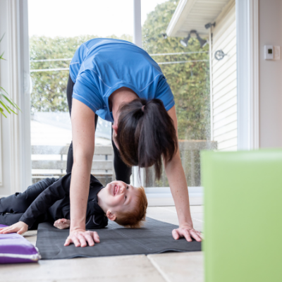 Mother and son doing yoga home workout. How to Create Healthy Habits in Your Family - Whole Family Living