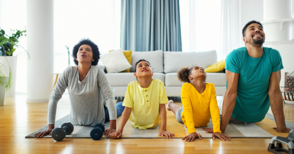 Family doing stretching exercises at home, home workout. How to Create Healthy Habits in Your Family - Whole Family Living