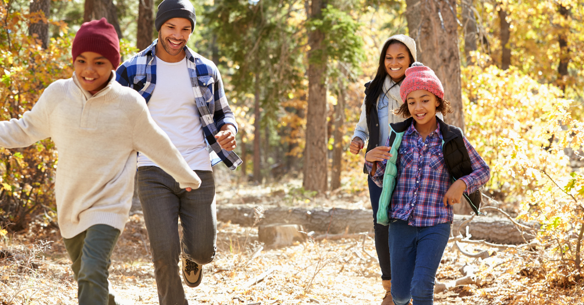 Young African-American family walking outdoors for exercise. Healthy Family Habits for Activity - Whole Family Living