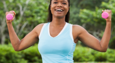 African American woman exercising in the park with hand weights. How to Start a Healthy Lifestyle - Whole Family Living