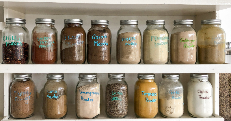Dry herbs and spices in storage containers. How to Stock a Healthy Pantry - Whole Family Living